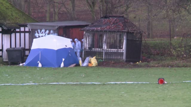 friends pay tribute as police enquiries continue ENGLAND London Finsbury Park EXT Police forensic officers and forensic tent in cordonedoff area of...