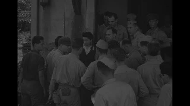 vídeos y material grabado en eventos de stock de iva toguri leaving building surrounded by soldiers / three shots of toguri talking to soldiers on steps of building / three shots of toguri standing... - iva