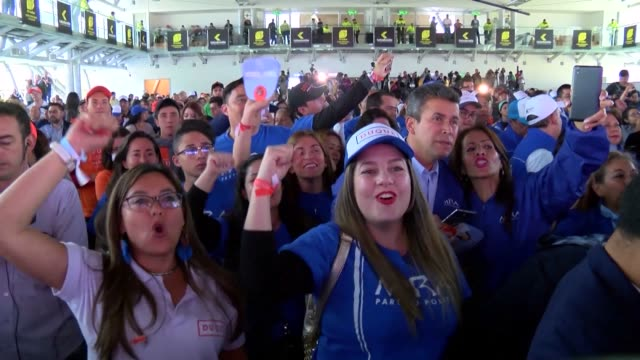 Ivan Duque's supporters celebrate him winning the Colombian presidential election