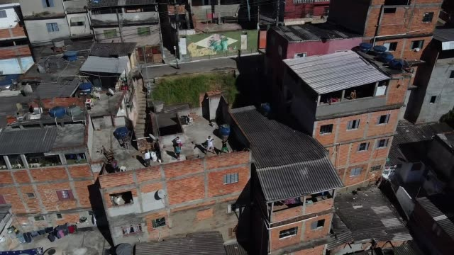 ivan pereira do nascimento, 39 years old, conducts training sessions from the roof of his house to residents of brasilandia amidst the coronavirus... - roof stock videos & royalty-free footage