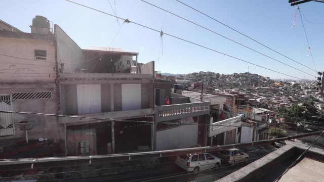 vídeos de stock, filmes e b-roll de ivan pereira do nascimiento 39 year old physical education student conducts training sessions from the roof of his house to residents of brasilandia... - pet equipment
