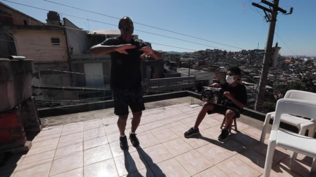 vídeos de stock, filmes e b-roll de ivan pereira do nascimiento 39 years old physical education student conducts training sessions from the roof of his house to residents of brasilandia... - pet equipment
