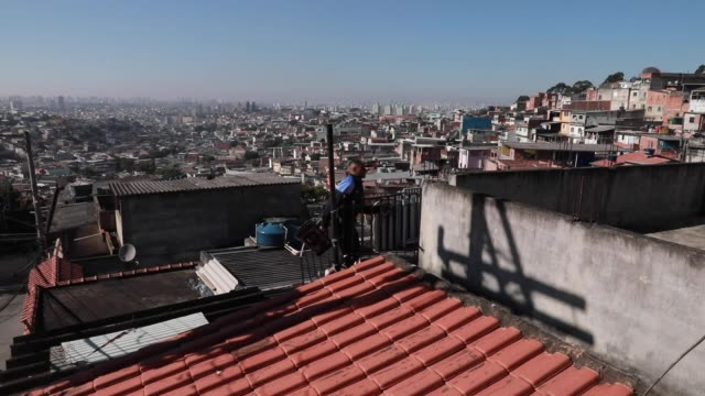 vídeos de stock, filmes e b-roll de ivan pereira do nascimiento a 39 year old physical education student walks up the stairs to conduct training sessions from the roof of his house to... - pet equipment