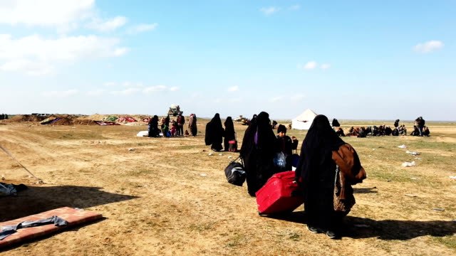 ivilians arrive at an sdf position on the outskirts of bagouz after walking hours to flee fighting on february 12 2019 in bagouz syria civilian... - syrian democratic forces stock videos & royalty-free footage