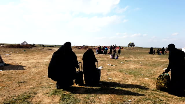 ivilians arrive at an sdf position on the outskirts of bagouz after walking hours to flee fighting on february 12 2019 in bagouz syria civilian... - syria stock videos & royalty-free footage