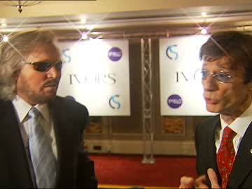 ivor novello awards 2006: arrivals / interviews / awards ceremony; england: london: ivor novello awards: int side view of barry gibb speaking to... - songwriter stock videos & royalty-free footage