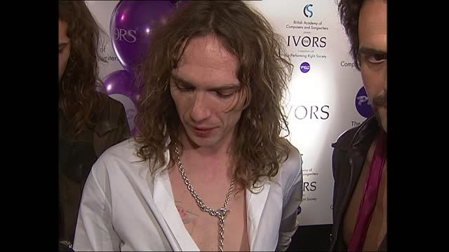 amy winehouse, errol brown and the darkness win; england: london: int tls side band members from 'the darkness' along past tables to collect ivor... - jo whiley stock videos & royalty-free footage