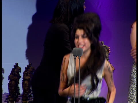 ivor novello awards ceremony general views and speeches; catherine tate on stage to give award as announcing amy winehouse as winner of best... - amy winehouse stock-videos und b-roll-filmmaterial