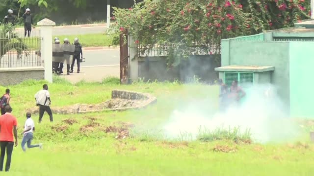 ivorian police use tear gas and stun grenades against stone throwing students protesting education fee hikes outside the houphouet boigny university... - hand grenade stock videos & royalty-free footage