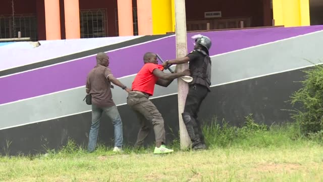 ivorian security forces stop a rally by the eds opposition coalition who wanted to protest against saturday's senatorial elections - côte d'ivoire stock videos & royalty-free footage