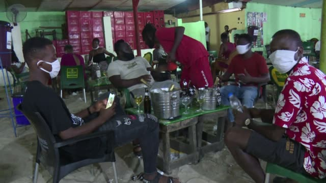 """ivorians are taking to the famous """"maquis"""" and other entertainment venues, while ivory coast has eased measures to combat coronavirus in abidjan - côte d'ivoire stock videos & royalty-free footage"""