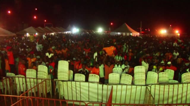 ivorians celebrate in the streets of abidjan as ivory coast wins their quarter final match against algeria in the afcon 2015 - internationaler fußball stock-videos und b-roll-filmmaterial