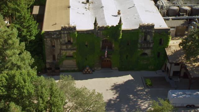 MS ZI AERIAL POV Ivy covered Chateau Montelena near Calistoga in Napa County / Calistoga, California, United States