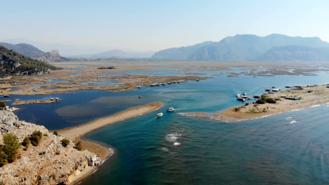 iztuzu beach from dalyan, turkey. daily boat trip. - dalyan stock videos and b-roll footage