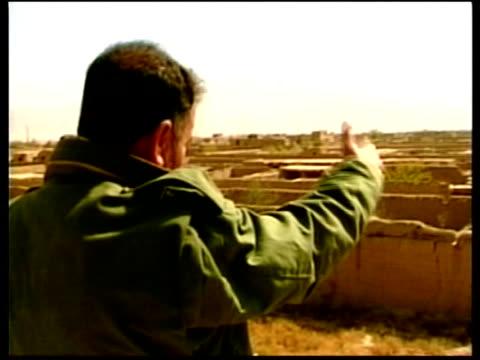 mujahideen soldiers standing around with truck full of soldiers in b/g ms mujahideen troops out of truck pull out cs mujahideen soldier with rifle... - bagram stock videos & royalty-free footage