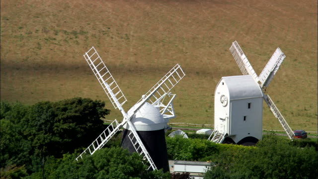jack and jill windmills on south downs  - aerial view - england, east sussex, wealden district, united kingdom - interconnect plug stock videos & royalty-free footage