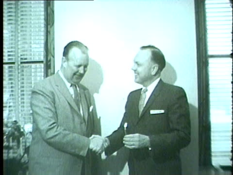 wgn jack brickhouse signs exclusive 5year contract with wgn shakes hands with ward quall wgn vice president and general manager blows out... - 1958 stock videos & royalty-free footage