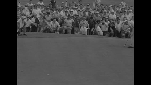 jack burke tees off / crowd walks on green / burke putts and goes wide of hole / ted kroll putts and misses / burke putts ball into hole / crowd... - pga stock videos & royalty-free footage