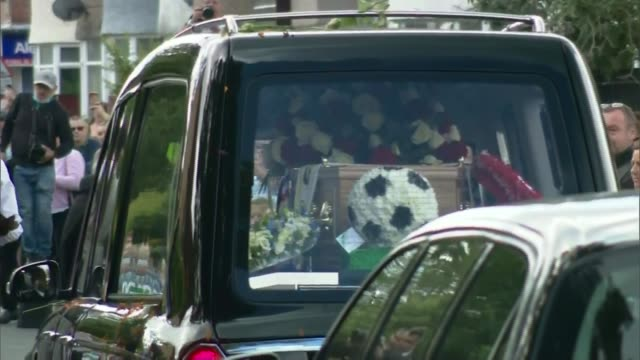 jack charlton funeral held in northumberland england northumberland ashington ext hearse arriving for funeral of jack charlton past applauding crowd... - jack charlton stock videos & royalty-free footage