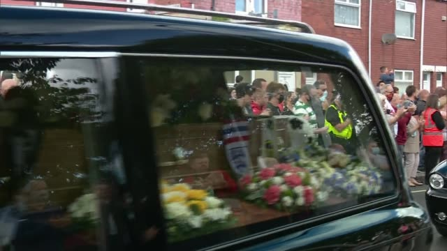 jack charlton funeral held in northumberland england northumberland ashington ext various shots of hearse along in cortege past applauding crowds on... - jack charlton stock videos & royalty-free footage