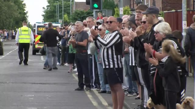 jack charlton funeral procession in northumberland england northumberland ashington ext procession and hearse with coffin of jack charlton along past... - jack charlton stock videos & royalty-free footage