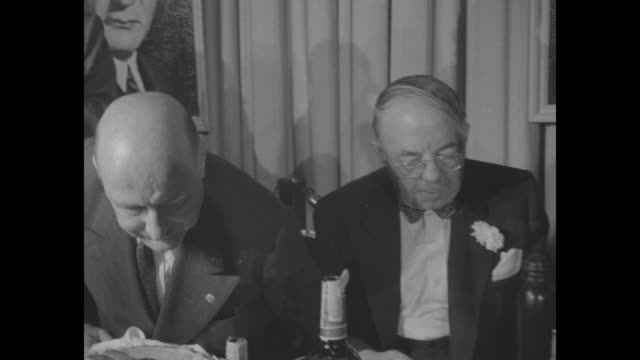 jack cohn seated at head table seated at head table of the dinner. - warner bros stock videos & royalty-free footage
