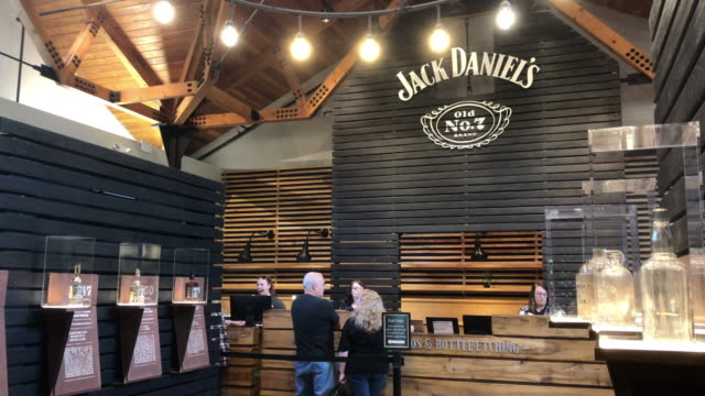 jack daniel's is a brand of tennessee whiskey and the top-selling american whiskey in the world.[5][6] it is produced in lynchburg, tennessee, by the... - ギフトショップ点の映像素材/bロール
