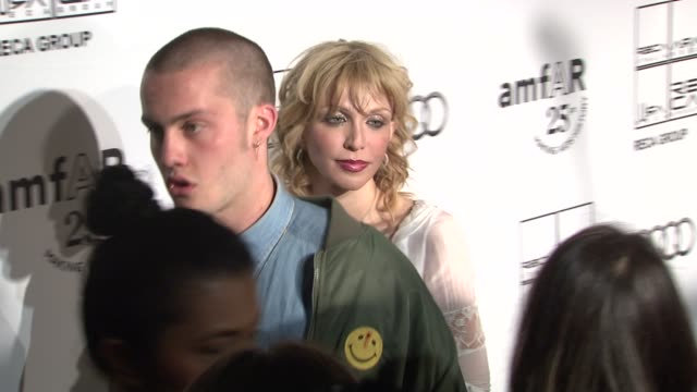 jack donoghue and courtney love at the 2nd annual amfar inspiration gala new york arrivals at new york ny - courtney love stock videos & royalty-free footage