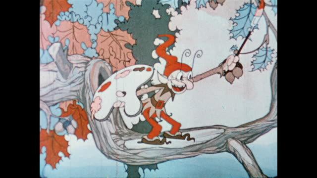 jack frost character painting acorn nuts and tree leaves with paint, warning animals to prepare for winter - エルフ点の映像素材/bロール