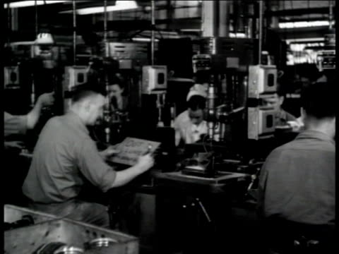 Jack Heintz Precision Industries Drill machine sitting idle worker placing sign on machine 'Out To Lunch with Adolf Hitler'