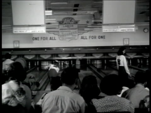 jack heintz precision industries jahco company bowling leagues ha ws women bowling w/ people seated watching women on lane throwing ball gives small... - ボーリング場点の映像素材/bロール