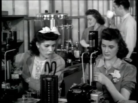 jack & heintz precision industries: women working w/ machine on table. male & female workers getting coffee from urn, taking break. - coffee break stock videos & royalty-free footage