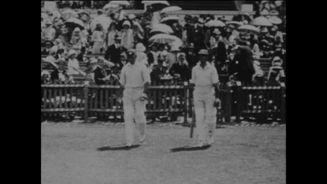 jack hobbs and herbert sutcliffe opening the batting for england during the 3rd ashes test match against australia at the adelaide oval in australia... - テストクリケット点の映像素材/bロール