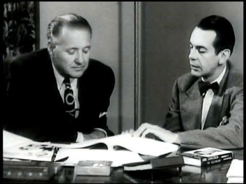 producing jack 'jl' warner at desk cu film titles george schaefer w/ actor raymond massey at desk cu 'abe lincoln' book walter wagner w/ 'personal... - disney stock videos and b-roll footage