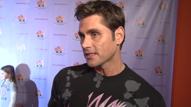 jack mackenroth talking about having hiv, the importance of the foundation and being at the carnival at the elizabeth glaser pediatric aids... - retrovirus video stock e b–roll