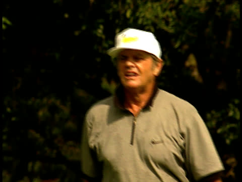 jack nicholson tees off, goes back to his cart and smokes a cigarette. - jack nicholson stock videos & royalty-free footage