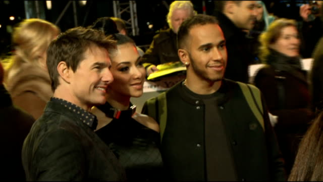 jack reacher red carpet interviews **music heard sot** cruise greeting lewis hamilton and nicole scherzinger - lewis hamilton nicole scherzinger stock videos and b-roll footage