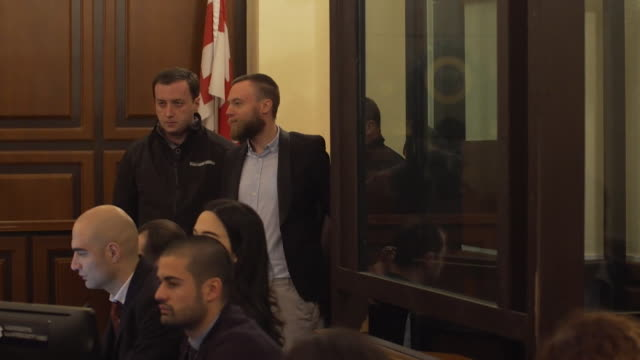 vidéos et rushes de jack shepherd fugitive found guilty of manslughter of charlotte brown appears in court in tbilisi after handing himself in - procès