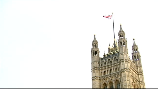 Jack Straw and Malcolm Rifkind suspended over 'cash for access' claims London Westminster Low angle view Union Jack flag flying above Houses of...