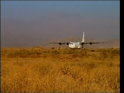 jack straw in iran / humanitarian response afghanistan bagram airbase c130 transport plane taxiing at airbase mss volunteers unloading boxes of aid... - jack straw stock videos and b-roll footage