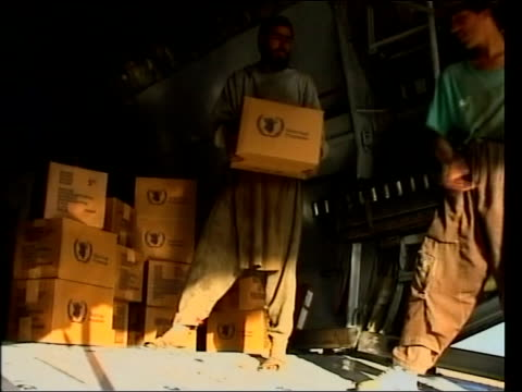 jack straw in iran / humanitarian response; bagram airbase: volunteers unloading boxes of aid from hold of un plane tx /ltn - bagram stock-videos und b-roll-filmmaterial
