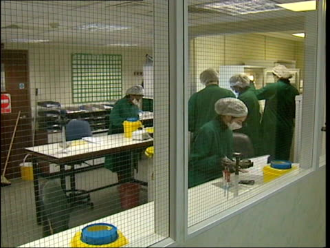 jack straw visits laboratory; england: london: int **please note: this is not an animal experimentation lab** lab technicians working in laboratory... - working animal stock videos & royalty-free footage