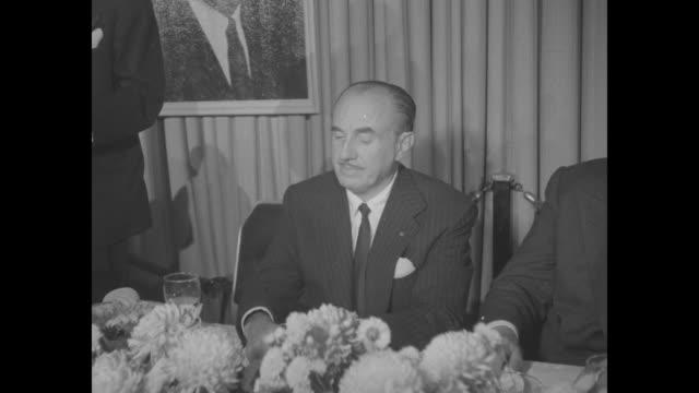 jack warner seated at head table at dinner honoring the warner brothers. - warner bros. stock videos & royalty-free footage