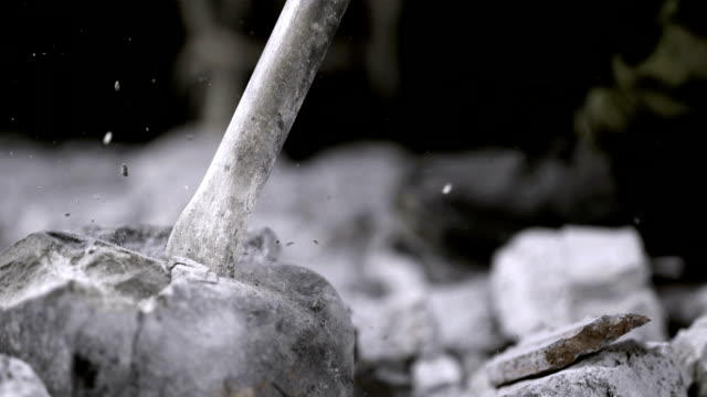 jackhammer breaking up rock (super slow motion) - stone object stock videos and b-roll footage