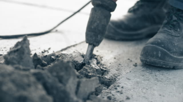 jackhammer chiseling its way through concrete - working class stock videos & royalty-free footage