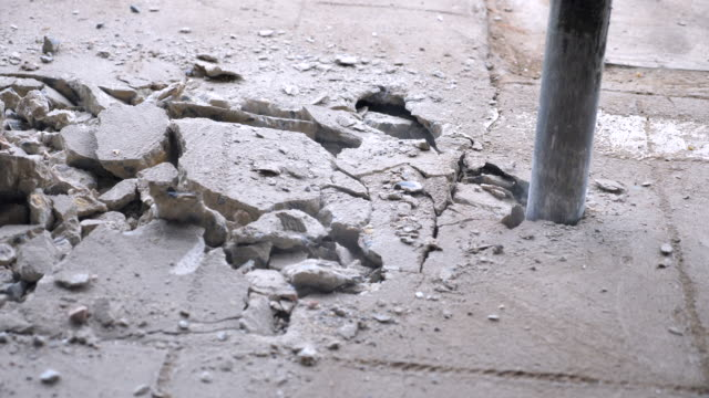 jackhammer digging  concrete floor, close-up shot - tarmac stock videos & royalty-free footage