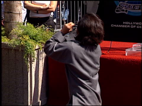 jackie chan at the dediction of jackie chan's walk of fame star at the hollywood walk of fame in hollywood, california on october 4, 2002. - jackie chan stock videos & royalty-free footage