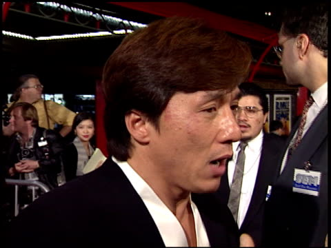 jackie chan at the 'rumble in the bronx' premiere at grauman's chinese theatre in hollywood, california on february 8, 1996. - jackie chan stock videos & royalty-free footage
