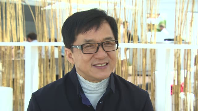 INTERVIEW Jackie Chan on 'Rush Hour 4' on working with Chris Tucker at 'Skiptrace' Interviews at Carlton Beach on May 17 2013 in Cannes France