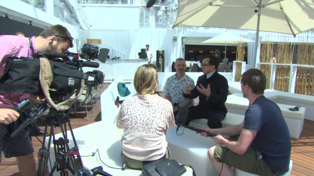 BROLL Jackie Chan Sam Fell at 'Skiptrace' Interviews at Carlton Beach on May 17 2013 in Cannes France